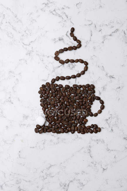 Coffee beans in shape of coffee cup — Stock Photo