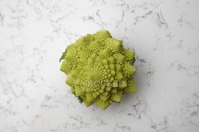 Romanesco cauliflower on marble — Stock Photo
