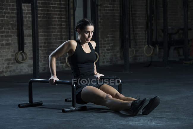 Woman exercising with floor bars — Stock Photo