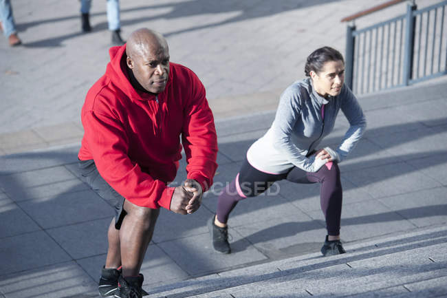 Woman exercising on steps — Stock Photo