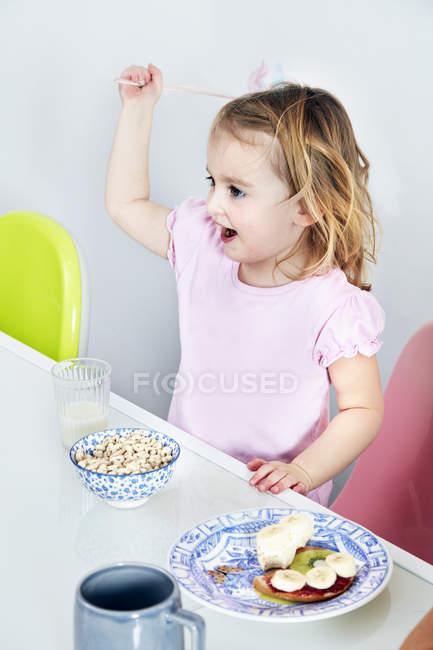 Girl having breakfast — Stock Photo