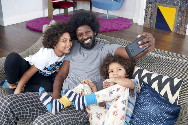 Father with children taking selfie — Stock Photo