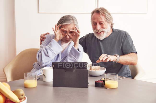 Senior couple enjoying video conference — Stock Photo