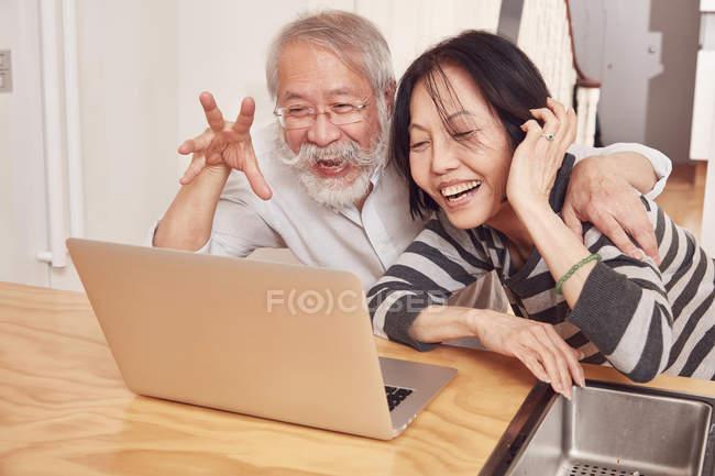 Couple enjoying video conference on laptop — Stock Photo