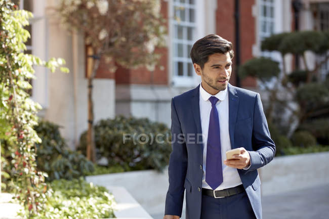 Businessman using smartphone — Stock Photo