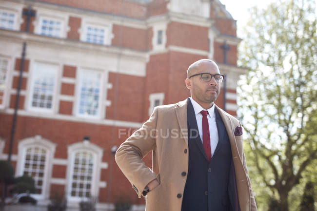 Businessman with hand in blazer pocket — Stock Photo
