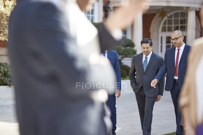 Businessmen walking together — Stock Photo