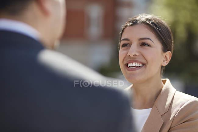 Businesswoman talking to colleague — Stock Photo
