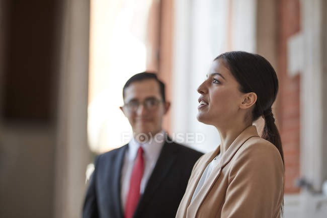 Businesswoman talking with colleague — Stock Photo
