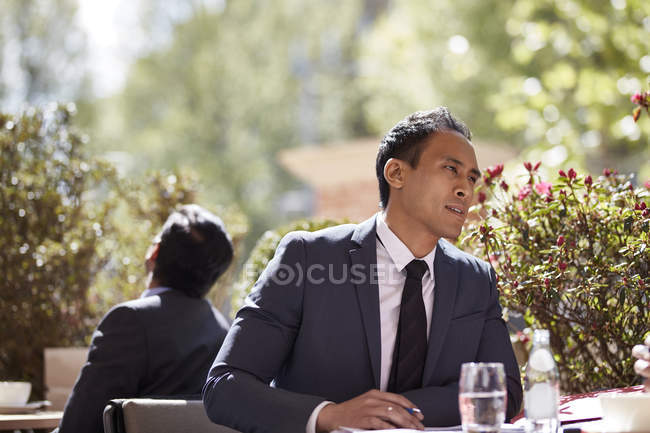 Businessman sitting in cafe during meeting — Stock Photo