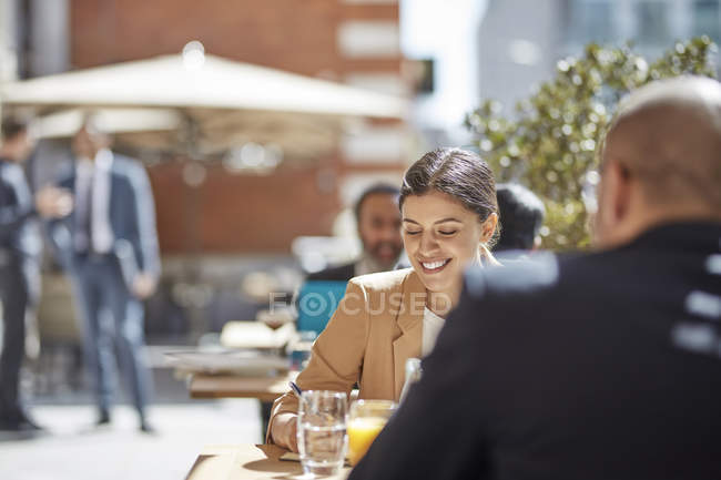 Businesswoman meeting with colleague — Stock Photo