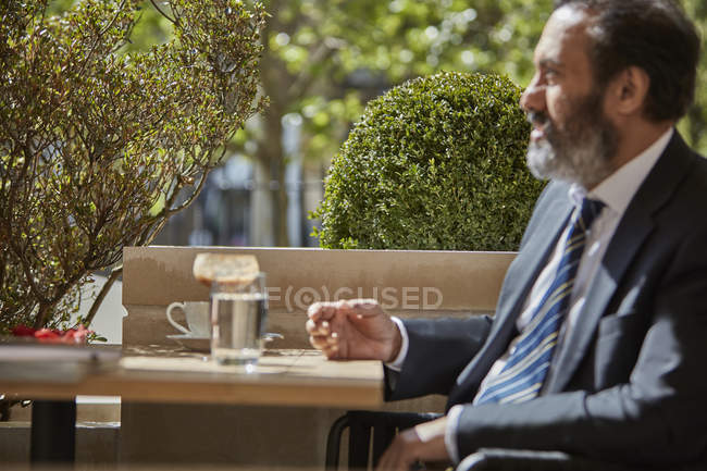 Businessman sitting at cafe — Stock Photo