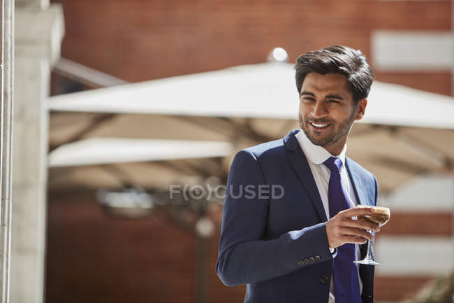Businessman holding glass of coffee — Stock Photo