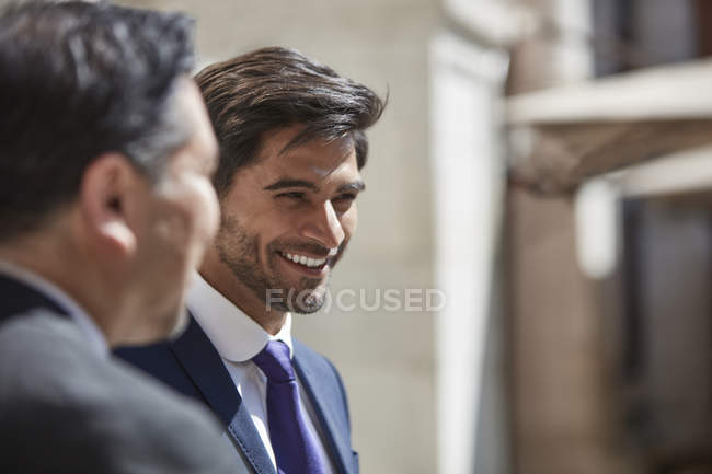 Businessman listening to colleagues — Stock Photo