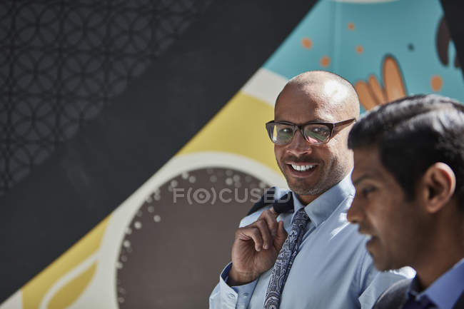 Businessman listening to colleague — Stock Photo