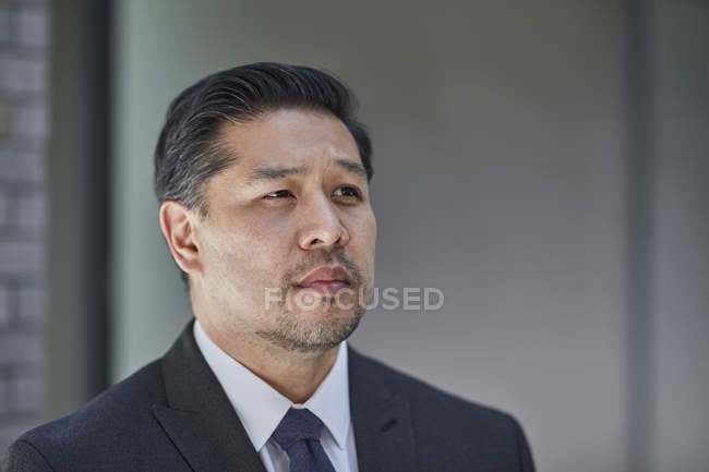 Businessman in suit looking away — Stock Photo