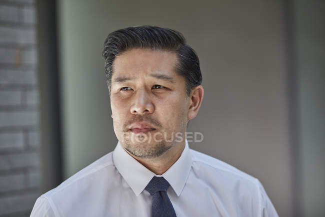 Businessman in tie looking away — Stock Photo