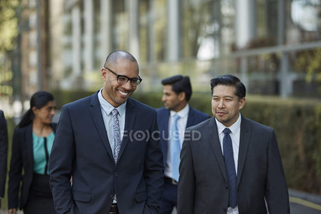Businesspeople walking together — Stock Photo