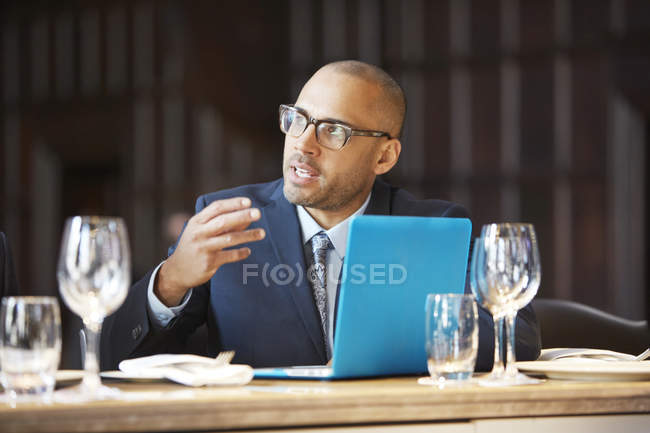 Businessman speaking at meeting — Stock Photo