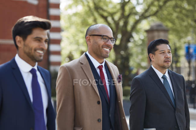 Businessmen walking on hotel area — Stock Photo