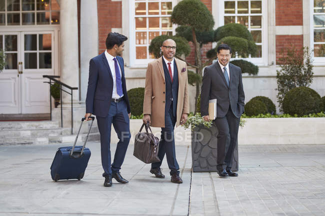 Businessmen walking togehter — Stock Photo