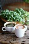 Чашки кави з americano та капучино — стокове фото