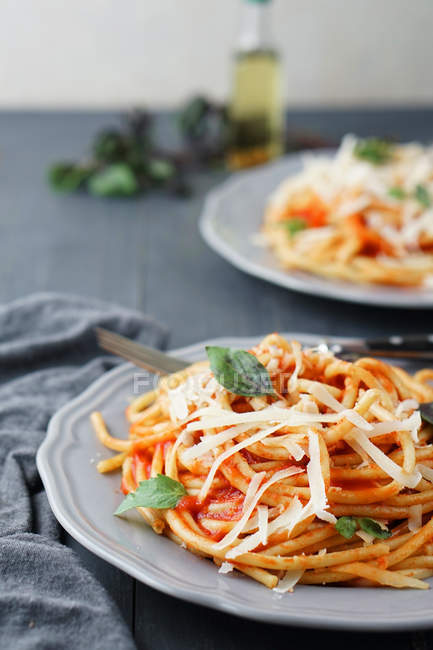 Spaghetti pasta with grated parmesan cheese — Stock Photo