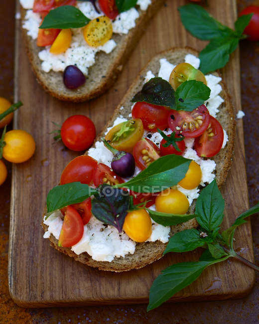 Sandwich with cheese, tomatoes and basil — Stock Photo
