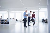 Colleagues working in open plan office — Stock Photo