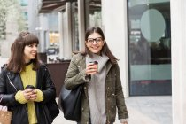 Two young women with takeaway coffee — Stock Photo