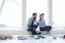 Female and male interior designers — Stock Photo