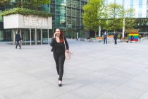 Businesswoman walking and making call — Stock Photo