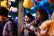 Girls drinking ice drinks — Stock Photo