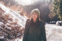 Female hiker hiking along forest road — Stock Photo