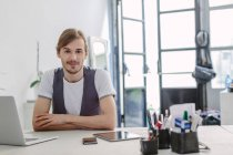 Portrait of bearded man at desk — Stock Photo