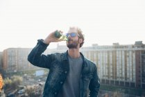 Young man drinking beer — Stock Photo