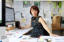 Female designer at office desk — Stock Photo