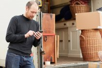 Man standing by removal van — Stock Photo