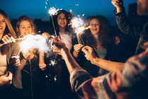 Group of friends enjoying roof party — Stock Photo