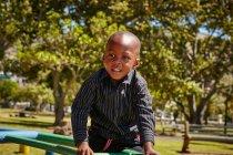 Boy on climbing frame — Stock Photo