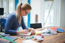 Female designer making notes — Stock Photo