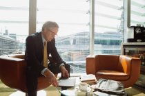 Businessman in coffee area in office — Stock Photo