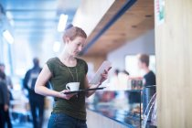 Student at cafe in library — Stock Photo