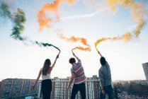 Group of friends on roof — Stock Photo
