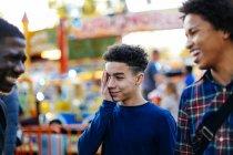 Three boys at funfair — Stock Photo