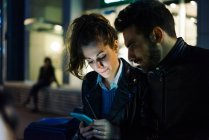 Couple using mobile phone — Stock Photo