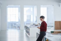 Woman working in open plan office — Stock Photo