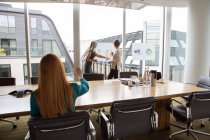 Businesswomen preparing presentation in meeting room — Stock Photo