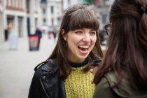Women chatting in street — Stock Photo
