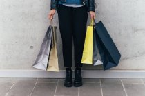 Woman standing with shopping bags — Stock Photo